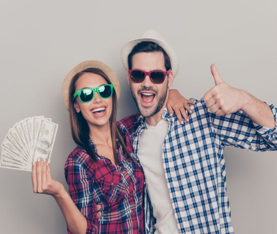 happy couple holding cash